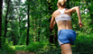 Female runner staying in shape to prevent back pain.